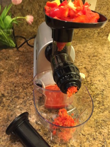 Run the red peppers, celery and ginger root through the juicer.