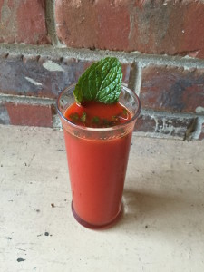 Pour the juice in a glass along with a crunched up handful of mint and add stevia, if desired.